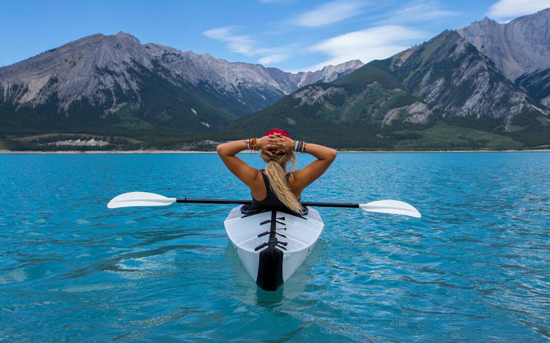Woman in kayak on a mountain lake